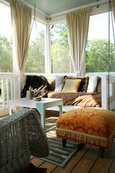 Back porch ideas...railing with curtains!?  Cute.  This is REALLY what I want to do to my back porch!