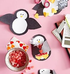Penguin Valentine: Hearts will melt over this colony of chill, candy-filled cuties! Trace our penguin template onto black and white paper, cut out, and assemble using a glue stick. Cut a beak and hearts for feet out of yellow paper, and attach along with googly eyes. Fold the wings around a bag of treats, and close with a sticker.