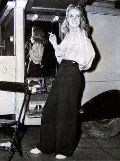 Betty Grable rocking a pair of wide-legged trousers 40s fashion style women vintage pants war era WWII pin up