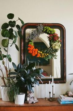 Bring nature indoors with a wreath made of flowers from your garden. Rubyellen Bratcher (abeautifulmess.com) created her arrangement by grouping bands of flowers around an 18-inch grapevine wreath.  More blogger projects we love: http://www.midwestliving.com/homes/seasonal-decorating/7-spring-blogger-projects-we-love/?page=5