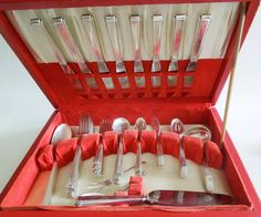 """An American art deco style canteen (flatware set) for eight, in the 'Modern Classic' pattern in its original wooden case. 8 Table knives (Stainless blades) 9.5"""" 8 Table forks (1 later)7 5/8"""" 8 Round bowl soup spoons 6 3/8"""" 8 Salad forks 6.24"""" 16 teaspoons 6 1/8"""" 8 butter knives 6 """" 3 Serving spoons 8 1/2"""" Cake server (Sterling handle, stainless blade). Sauce spoon Sugar tongs Lemon fork Small fork Jam spoon HEIGHT:3.15 in. (8 cm) WIDTH:16.14 in. (41 cm) DEPTH:11.42 in. (29 cm)"""