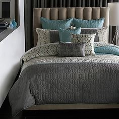 Bring a sophisticated look to your bedroom with the Bryan Keith Bedford Reversible Comforter Set. Inspired by geometric architecture, this design is rendered in cool teal, grey and cream hues for a modern sophistication.