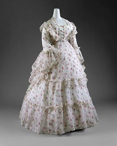 French Dress - early 1870's - reflects the romanticism of Renoir paintings. This summer dress would have been worn for afternoon tea or reception.