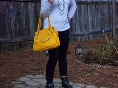Bows and Clothes. Edgy Cute. Black skinnies, yellow purse, black ankle boots, pocket tee, green necklace.