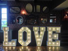 Light up LOVE letters from @Lighthausevents under the mirrors at The Battleaxes www.littleweddinghelper.co.uk