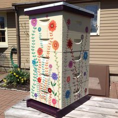 My new hand-painted hive. Hope the bees like it!