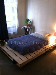 DIY Unique Style Pallets Bed. Miss sleeping on the floor...