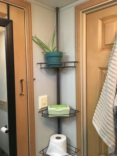 Shower shelf extra storage idea for bathroom organization in campers, travel trailers, motorhomes, RVs
