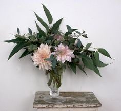Ariel Dearie arrangement--love the pale pink among the rich green. Also deliciously understated setting