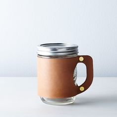 This would solve my problem of constantly spilling coffee on myself while walking to the car. Maybe. Leather Mason Jar Mug Sleeve on Food52
