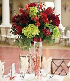 Red and Green Centerpiece Floral Design with red mini orchids inside clear vase