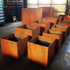 A batch of Corten Steel Planter Boxes with a rust patina. By Architectural Elements ArchEle