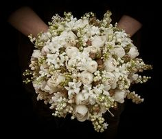 Round Wedding Bouquet Featuring: White Hyacinth, White Andromeda, White Lily Of The Valley, White Buds