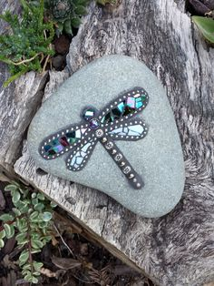 I created this dragonfly mosaic decorative rock with iridescent mosaic glass, metal chain and silver-colored beads. This would look amazing in your