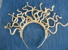 This Medusa headband consists of gluing plastic snakes to a headband and spray-painting it gold.