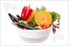 Picture of Colander with mix of vegetables isolated on white background.