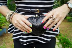 Rainbow nails and sequin heart clutch