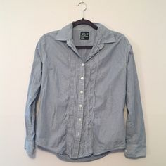 American Eagle Blue & White Pinstripe Button Down This is a very lightly worn button down oxford from American Eagle. It has some cute embroidering on the front on either side of the buttons. American Eagle Outfitters Tops Button Down Shirts