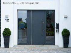 puerta-de-aluminio-contemporanea-al-frente-de-una-casa.jpg (569×425)