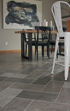 Luxury Vinyl Tile: Alterna 8x16 Enchanted Forest colors Forest Fog, Night Owl, and Tender Twig Herringbone mix pattern.