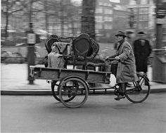 1960's. Transportation of antique chairs with a transportation bike across the Rembrandtplein in Amsterdam. Photo Dolf Toussaint. #amsterdam #1960 #Rembrandtplein