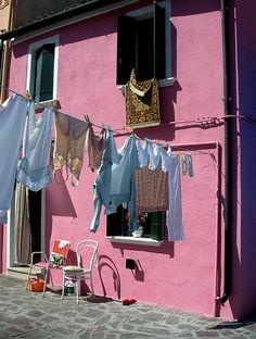 clothesline on a pink house.
