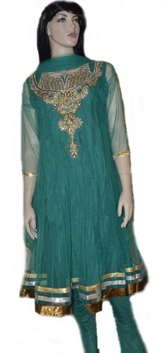 This Teal colored  readymade net churidar Anarkali style kameez is adorned with  stones, zari, patch patti, sequins work. Matching churidar and attractive dupatta comes along with it. Slight variation in color and patch patti is possible. This Anarkali has net sleeves but short sleeves are also provided with the suit that can be stitched on if desired.