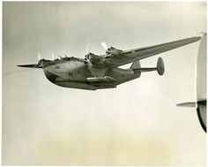 """December 7, 1941. Stranded. Six days from its home port of San Francisco, this Boeing 314 flying boat, the """"Pacific Clipper,"""" was preparing to alight in Auckland, New Zealand, as part of the airline's transpacific service when the crew of ten learned of the Japanese attack on the U.S. fleet at Pearl Harbor. Where to go? Forced to fly west, they made the first around the world flight by a commercial airliner — the hard way."""