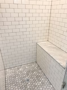 Shower with subway tile, and Carrara marble