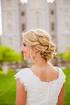 lovely curled and braided bridal updo ~ we ❤ this! moncheribridals.com