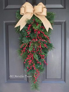 Red Berry Christmas Teardrop Wreath. Perfect for winter and Christmas home and door decor, and gifts. Decorative red berries, burlap bow, artificial pine.