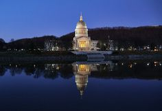https://flic.kr/p/aU4w2X | The West Virginia State Capitol Building in Charleston, WV | As I  was traveling through Charleston, the capital of West Virgina, during blue hour (my favorite time of day) a couple of days after Thanksgiving, I happened upon this beautiful sight of the State Capitol Building reflected in the Kanawha river flowing by in total stillness, so I just had to stop and capture the scene.