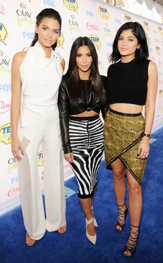 Sister act! Kim and Kendall, looking flawless in Balmain and Oriett Domenech respectively, join birthday girl Kylie, wearing Sass & Bide, on the blue carpet.
