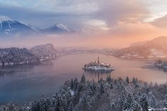 """Winter bliss - The first sunrise of 2015. Lake Bled at its best.  <p>Join my <a title=""""Slovenia winter photo workshop"""" href=""""http://lukaesenko.com/tours-workshops/slovenia-winter-photo-workshop/"""">Winter photography workshops</a> to Lake Bled and Julian Alps.</p>  <p>And follow my <a href=""""https://www.facebook.com/lukaesenkophotography"""">FB page</a> or <a href=""""https://twitter.com/lukaesenko"""">Twitter</a>. Thanks!</p>"""
