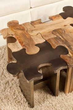 """Journey  Puzzle Silver Stool  The Puzzle stool / table is a great conversation starter. With is unique puzzle pieces combined to make a perfect master piece.  - Puzzle motif  - Mango construction  - SIlver finish  - Sold individually   - 22.5"""" W x 14"""" D x 17"""" H  Retails for $600.00"""