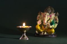 Download more Premium stock photos on Freepik Art Template, Templates, Ganesha Pictures, Lord Ganesha, Candle Holders, Candles, Indian, Stock Photos, Idol