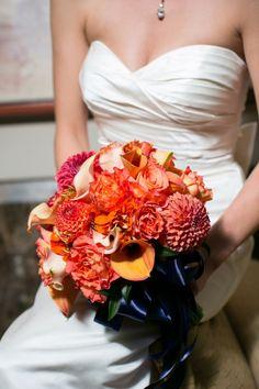 Orange dahlias, free spirit roses, peach callas, orange zinnias, peach mozart mini callas, and orange mini callas