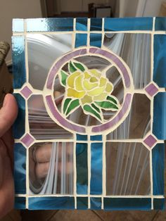 A personal favorite from my Etsy shop https://www.etsy.com/listing/248334334/reduced-yellow-rose-suncatcher-ready-to