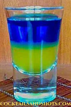 For the Ukrainian Flag shot you only need 2 ingredients: pineapple juice and Blue Curaçao. Pour the pineapple juice into your shot glass and then gently pour the Blue Curaçao over a bar spoon against the inside of your shot glass. #winterdrinks #martinirecipes #christmasdrinks #holidaycocktails New Years Eve Drinks, New Year's Drinks, New Year's Eve Cocktails, Holiday Cocktails, Non Alcoholic Drinks, Cocktail Drinks, Best Cocktail Recipes, Martini Recipes, Bar Spoon