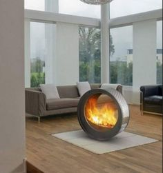 Round Shape Fireplace Idea. This is inside. Fire. In the house. Wood floor. wow.