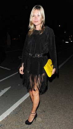 Suede fringe dress with a yellow clutch.