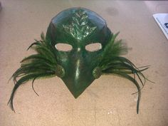 Bird Mask created by me, made using a plaster cast mould of my sons face and then paper machie clay to build. Emu feathers hand dyed.