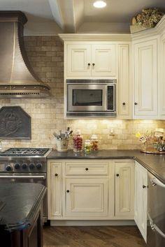 Mediterranean Kitchen Design Travertine Tile Backsplash White Cabinets Wood Flooring