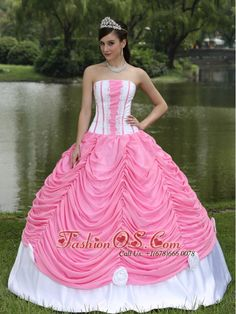 Custom Made Quinceanera Dress With Strapless Ball Gown Rose Pink and Pick-ups www.fashionos.com They show just enough skin to be classy without being too revealing. This one features white sheathy bodice with contrasting pink piping and ruching mid-section of the bodice,which do really create a fabulous look. The amazing ball gown skirt is made from several layers of ruched fabric that add another dimension of beauty to an already lovely gown. rose pink and pick ups quinceanera dress
