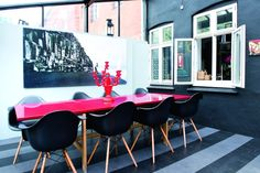 Love the hot pink dining table.  Image from BOLIG magazine.
