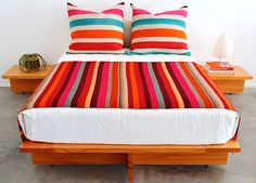 Mid Century Modern bedroom set with nightstands. I love the brightly colored fabrics that are Mexican blanket inspired.