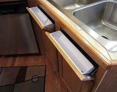 Turn the unusable under-the-sink panels into usable tilt-out storage cubbies! (Rev-A-Shelf tip out tray set- reportedly $18.57 at Lowe's for 2 tray set)