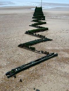 Richard Long. Reminds me of a marble run.