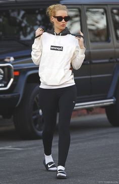 ★ ★ ★ ★ ★ five stars (black and white pinstripe hoodie, white pullover with a black graphic printed on, black leggings, white socks, black nike slides, red cat eye sunglasses)