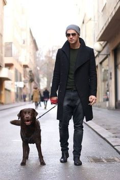 Men's Tobacco V-neck Sweater, Dark Brown Dress Pants, Black Leather Chelsea Boots, Grey Chambray Longsleeve Shirt, and Black Overcoat   Lookastic for Men